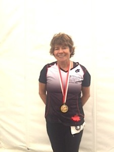Vi Woods wearing a gold medal for winning a dragon boat race