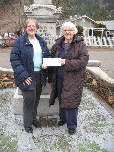 Peggy Terry (left) handing cheque to Museum Treasurer, Margaret Skaar