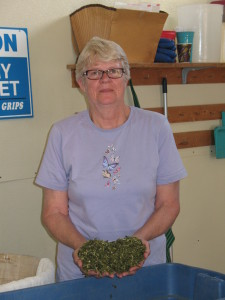Sharon McClennan holding a handful of spinach