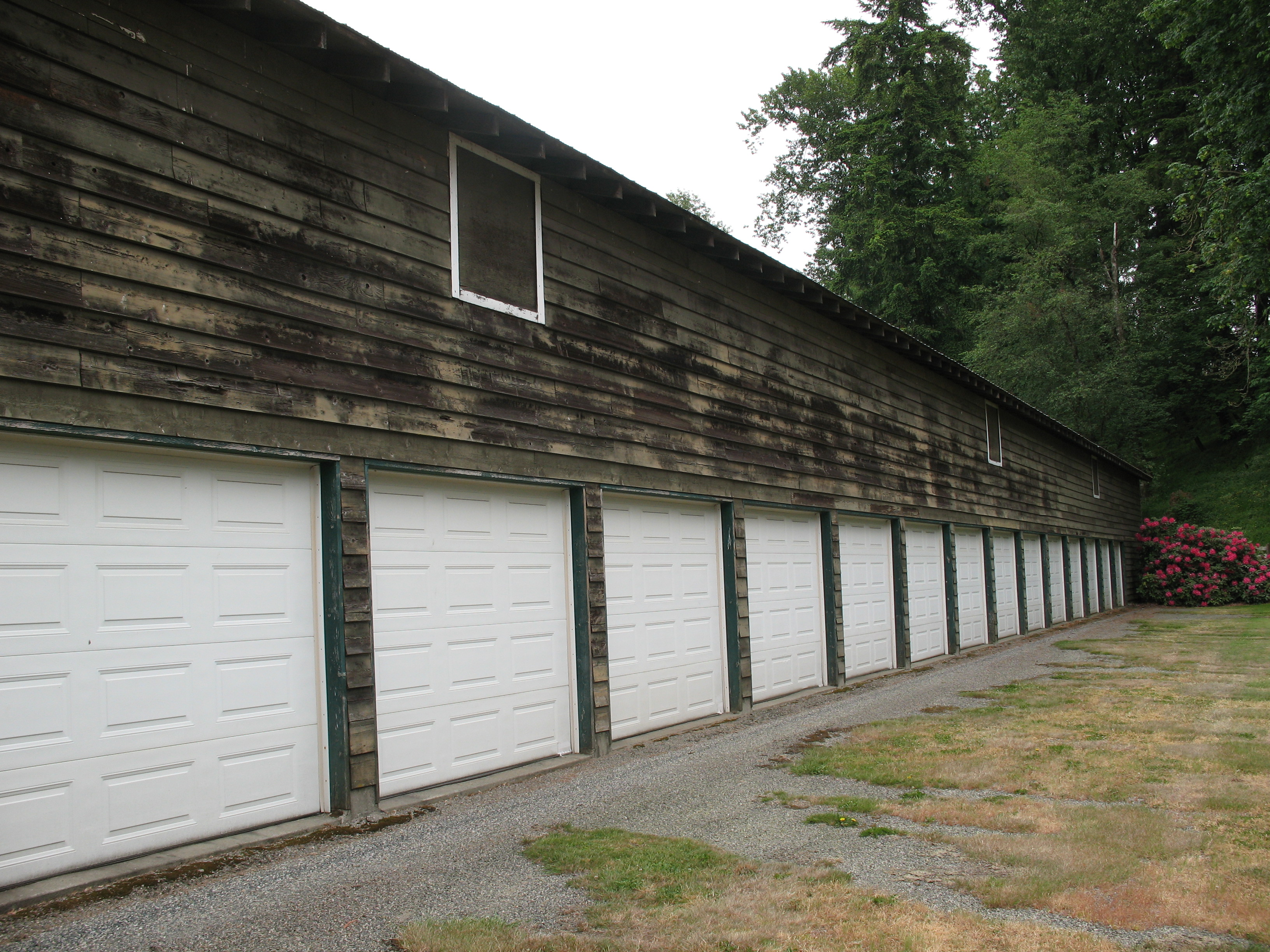 Converted poultry barn has a bay & a garage door for each restored classic car.