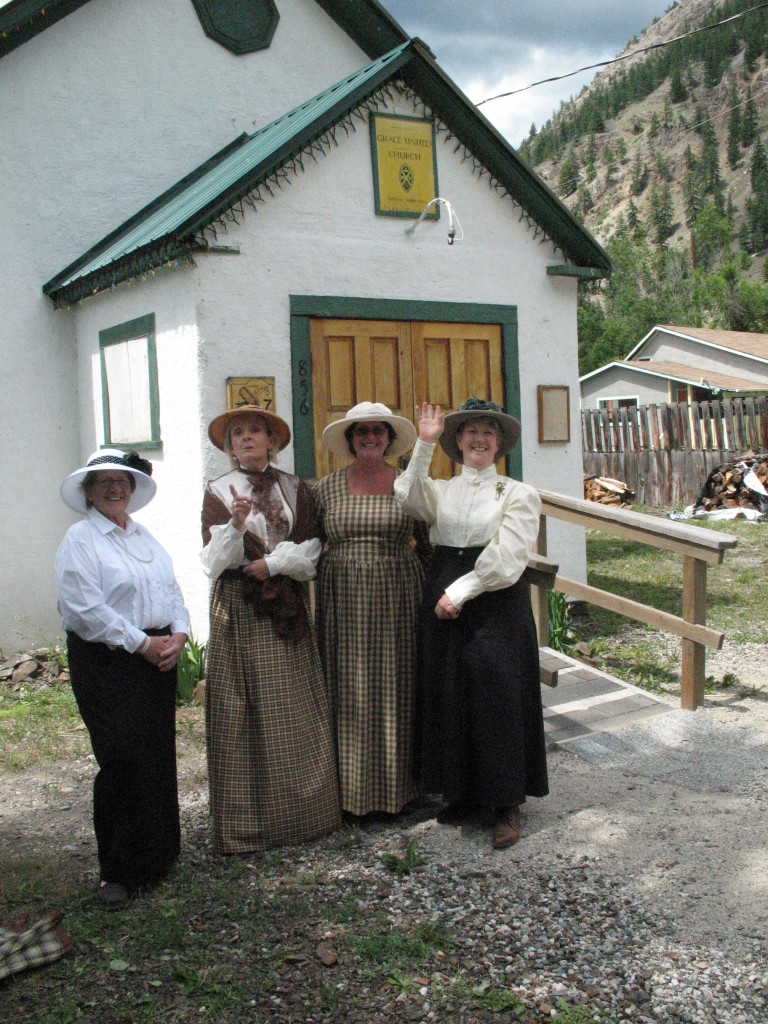 Hedley Heritage Ladies in front of the historic Hedley Grace Church