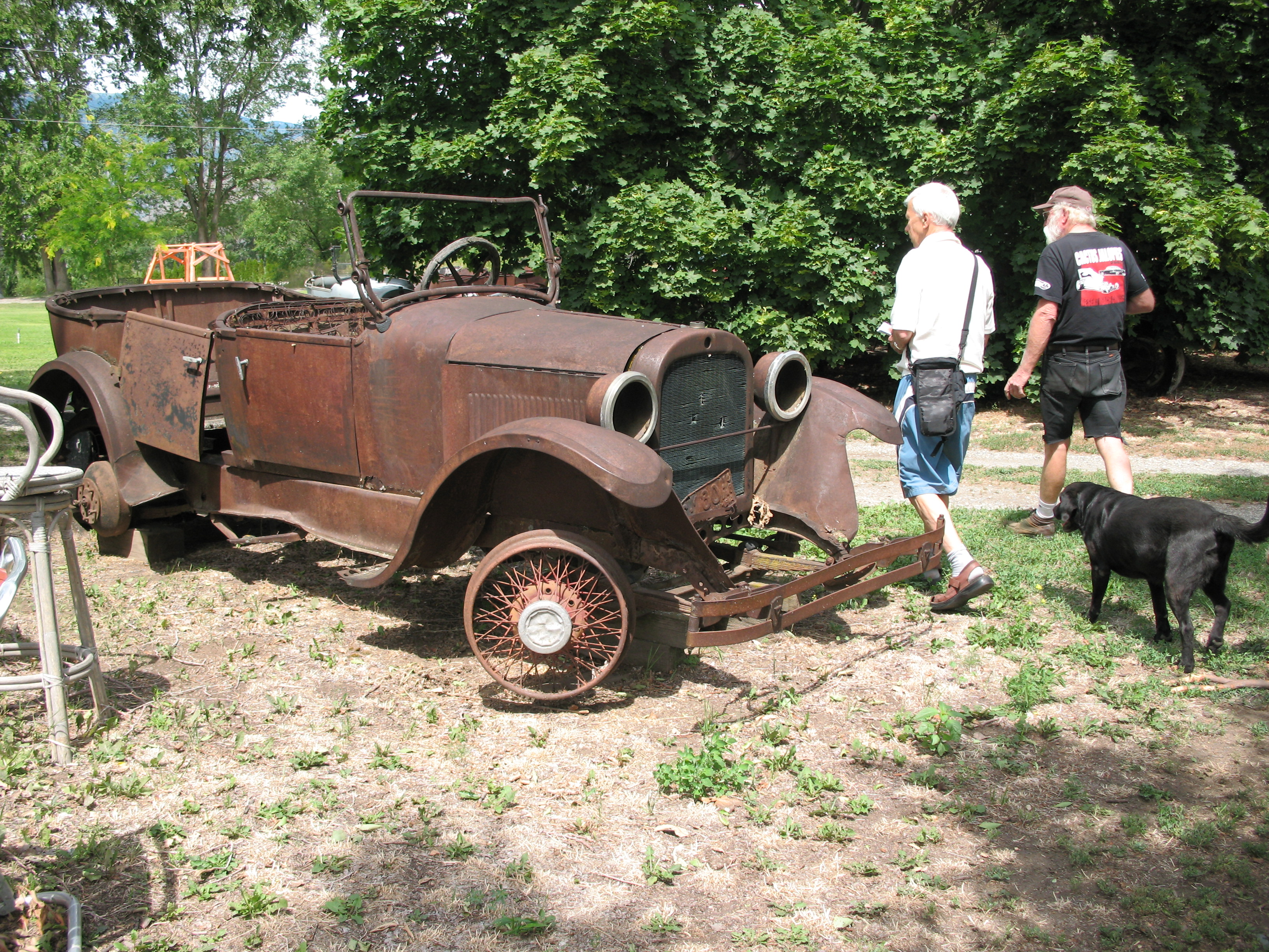"""What is a car?"" Ken asks, as we walk past an unrestored 1924 Dodge."