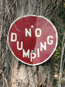 Sign painted on lid of dumped cyanide container.