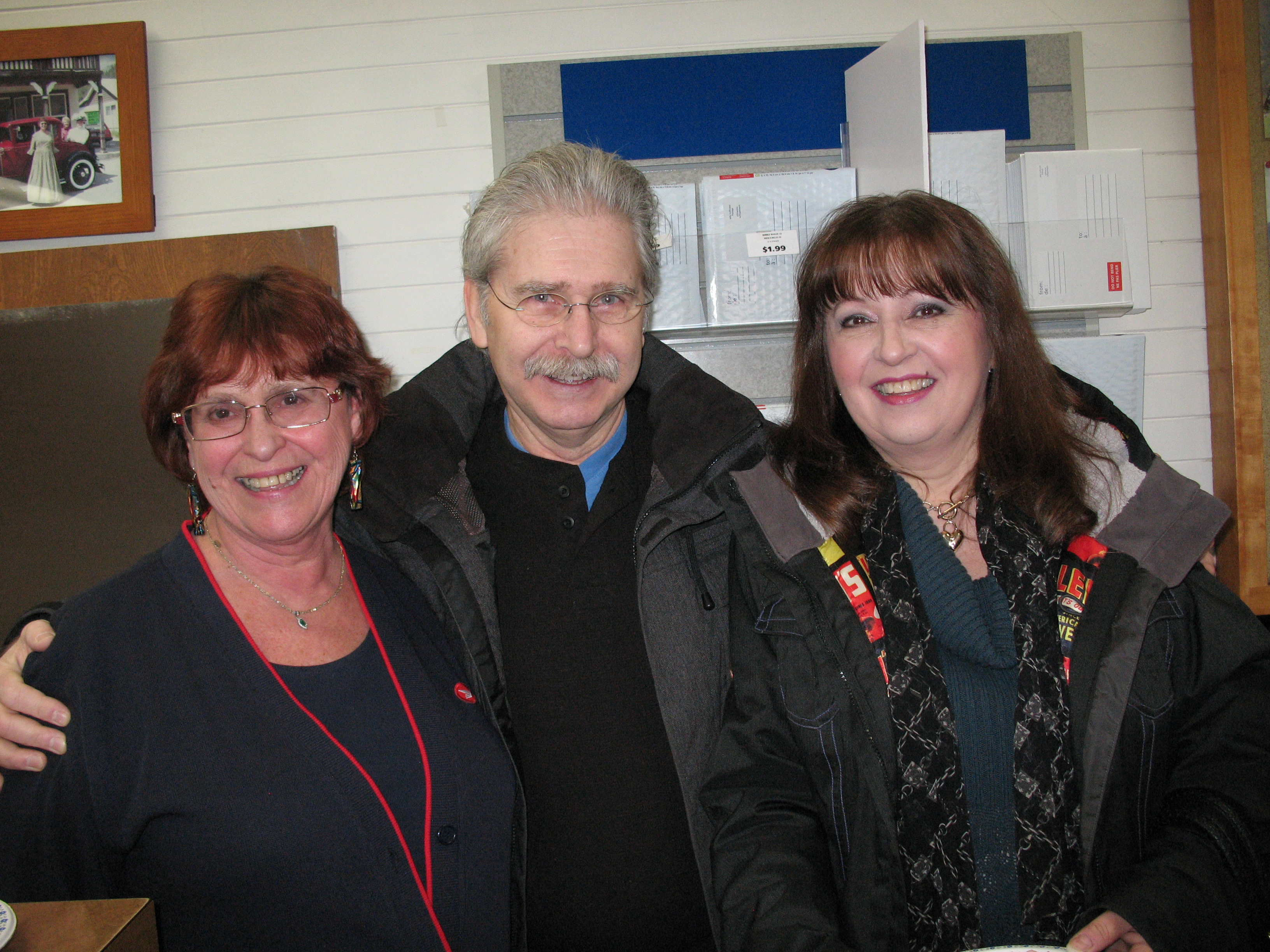 Postmaster Ruth Woodin  with loyal customers, Brad & Lana Bain