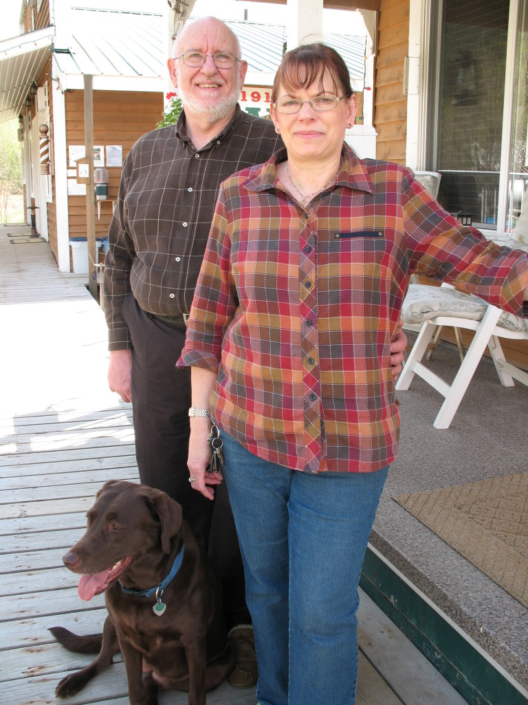 Bob & Diane Sterne in front of their home & motel office.
