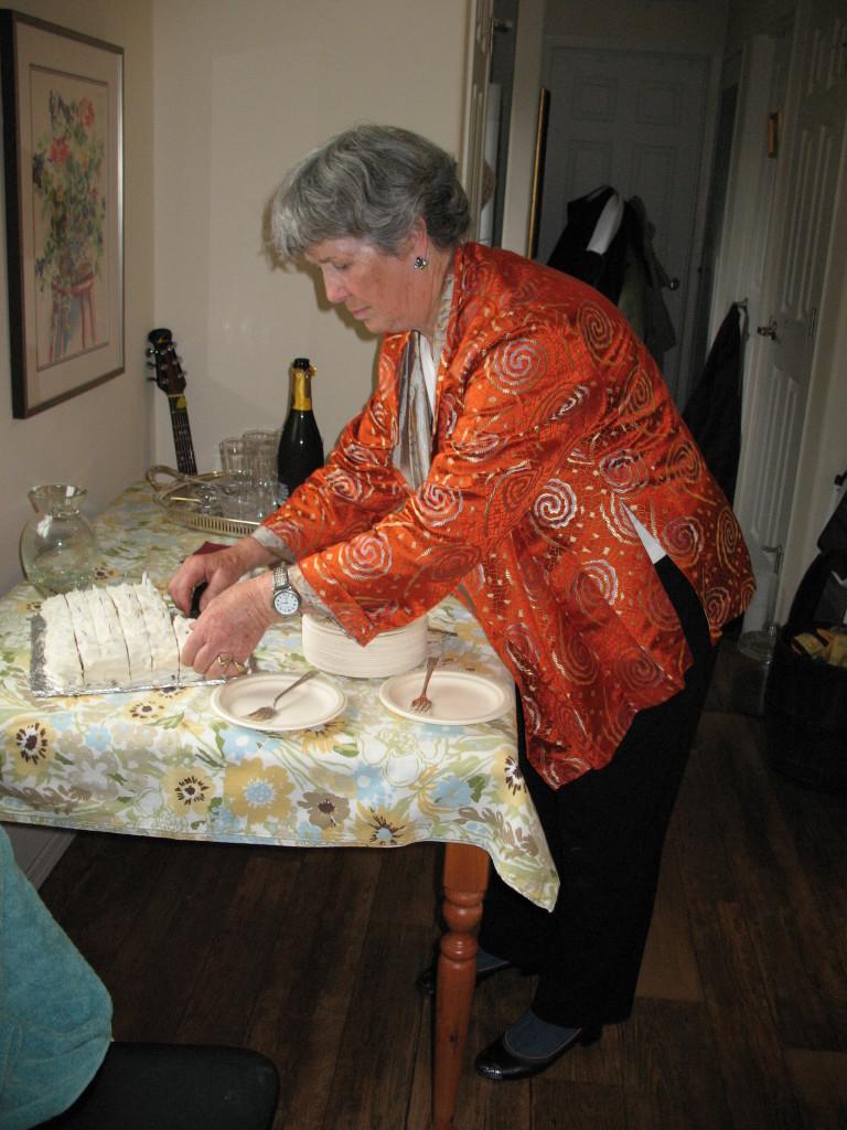 Lynn Wells served the birthday cake.
