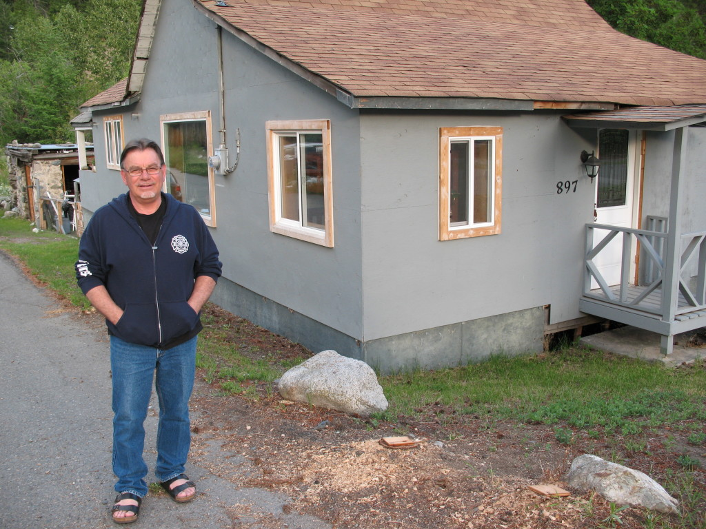Derek Lilly in front of a house in Hedley, where he lived with his grandparents for a number of years.