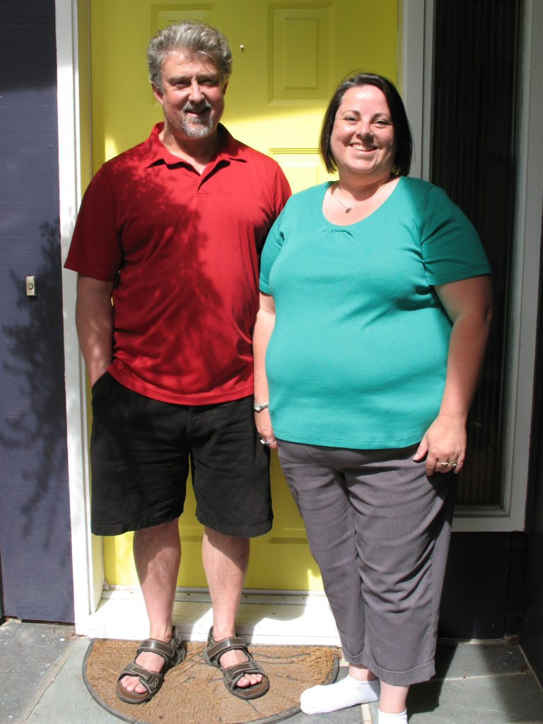 Martin & Rhianfa Riel at their front door.