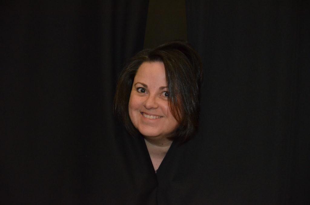 Rhianfa Riel looking out the stage curtains. (photo supplied by Rhianfa Riel).