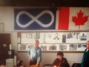 Harvey Donahue with Metis flag in the background