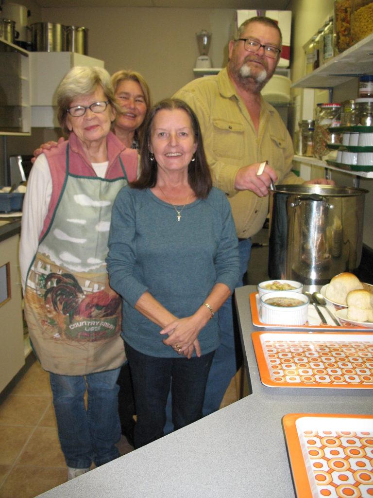 Kitchen volunteers Helga, Kathy, Joanne & Mike