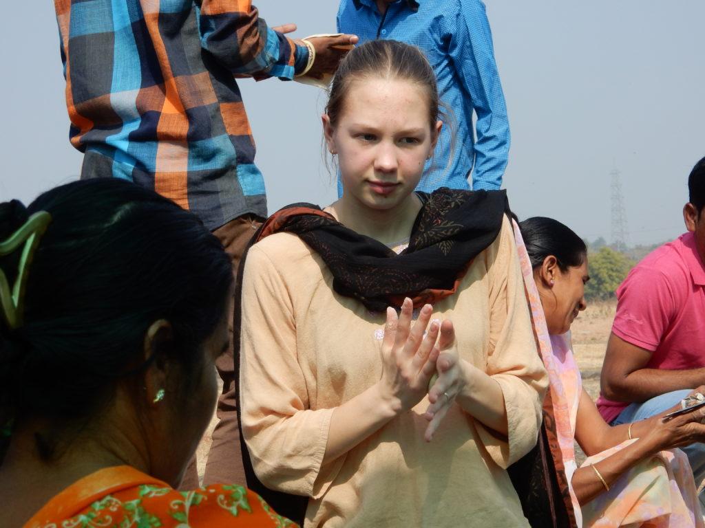 Ayrelea in India, rolling dough to make chapattis.