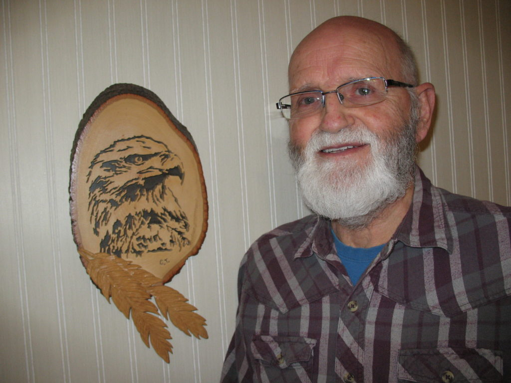 George with one of his wood creations.