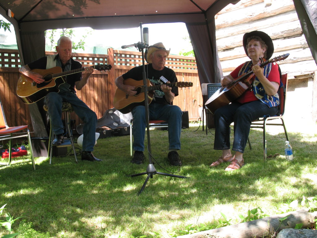 Harold Tuck, George Huber and Colleen Cox playing Bluegrass music.