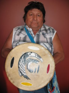 Oly Bent with his hand drum.